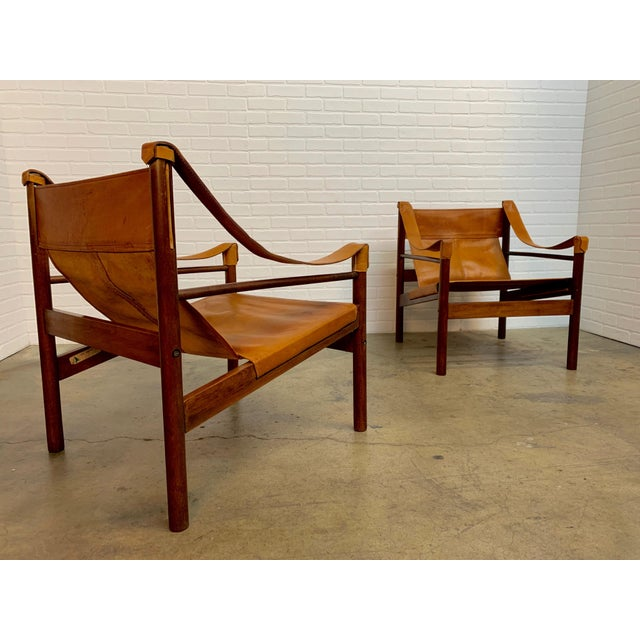 Pair of solid mahogany with caramel tan leather lounge chairs 1960s made in Argentina by Abel Gonzalez.