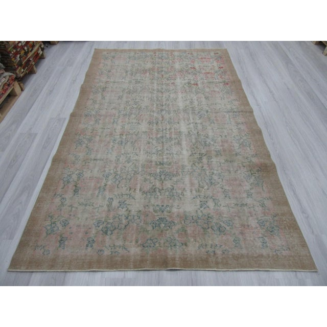 Vintage distressed rug from Oushak region of Turkey. Approximately 50-60 years old. In good condition