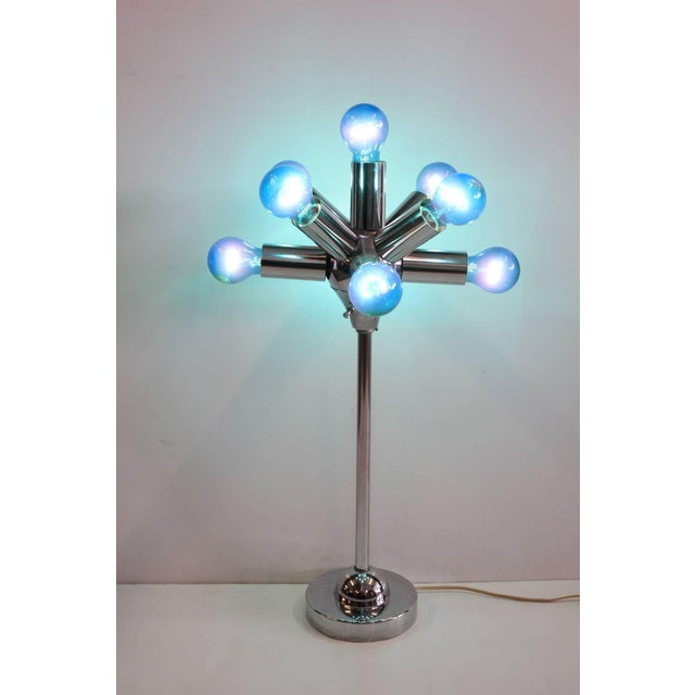 Mid-Century Sputnik table lamp with three-way switch. This piece would be a great in a modern study room.