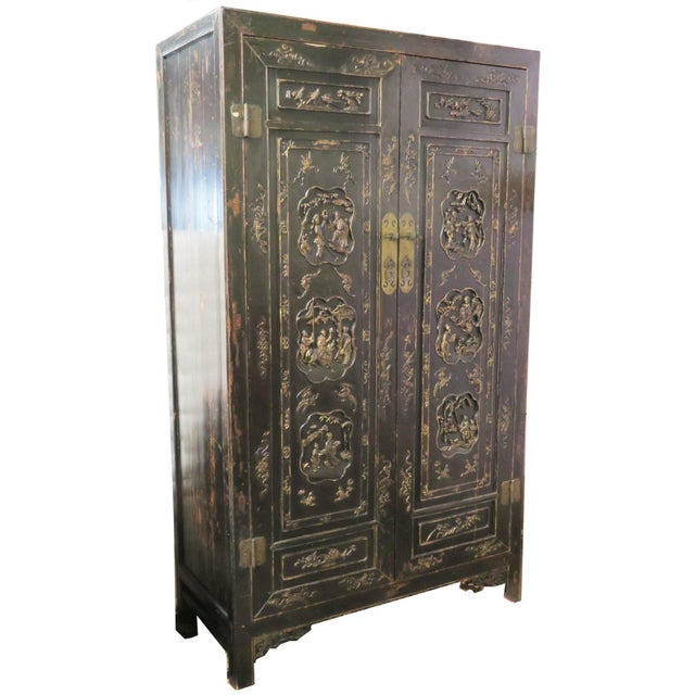 This large wardrobe/wedding cabinet has a simple rectangular shape with the top flush with all sides. The front has two...