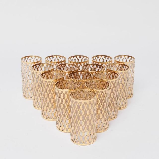 This charming set of gold embossed cocktail glasses are perfect for a cocktail party, indeed. Total of 15 glasses in the set.