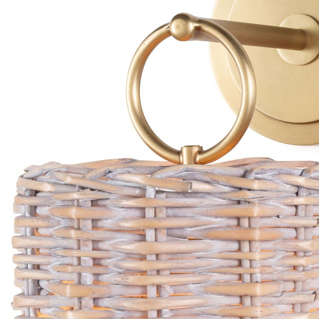 An intricate handwoven rattan shade is the focal point of this unique coastal sconce. The basket shade is perfectly...