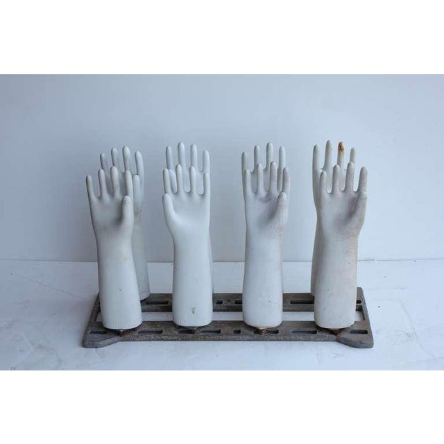 Set of 8 vintage porcelain glove molds on the stand.