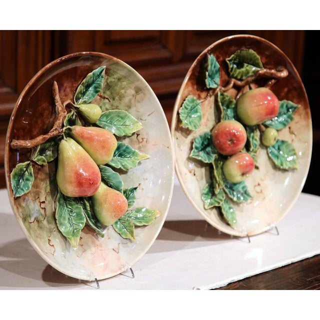 This beautiful pair of antique Majolica platters was sculpted in France, circa 1880. Each hand-painted plate features four...