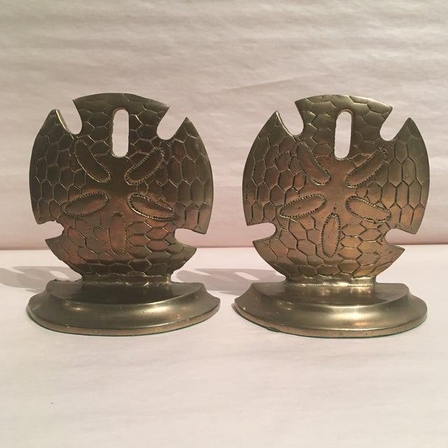 Fabulous pair of brass dollar Shell Bookends. These would make the perfect addition to any office, library, or beach...