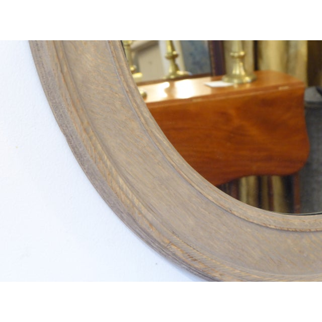 """19th Century oval oak mirror with weathered, grayed surface, generous oval, 35""""H x 29""""W."""