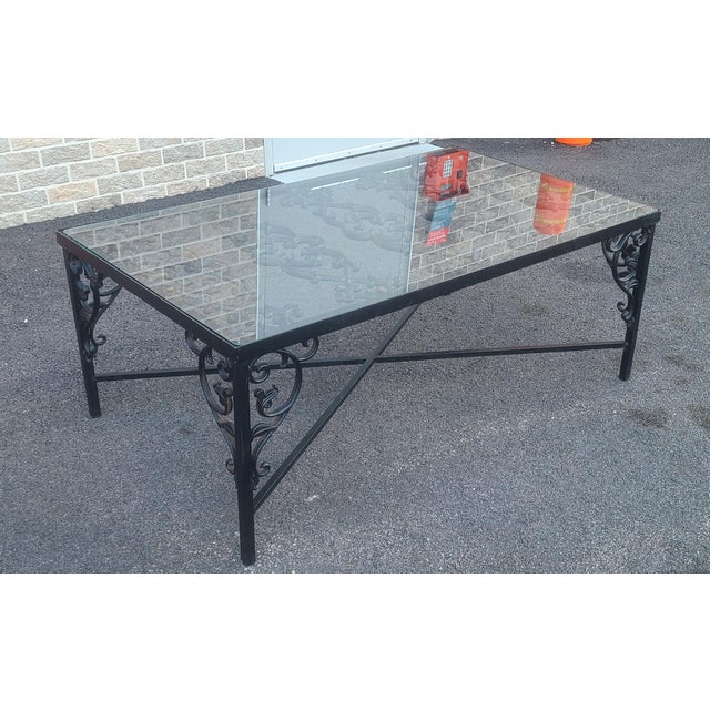 This is a very nice custom made wrought iron glass top coffee table. Fabricated from remnants of an antique French Gate....