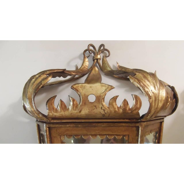 Whimsical Italian gilt toleware sconces with mirrored backs. Beautiful foliate design with glass panel front and sides....