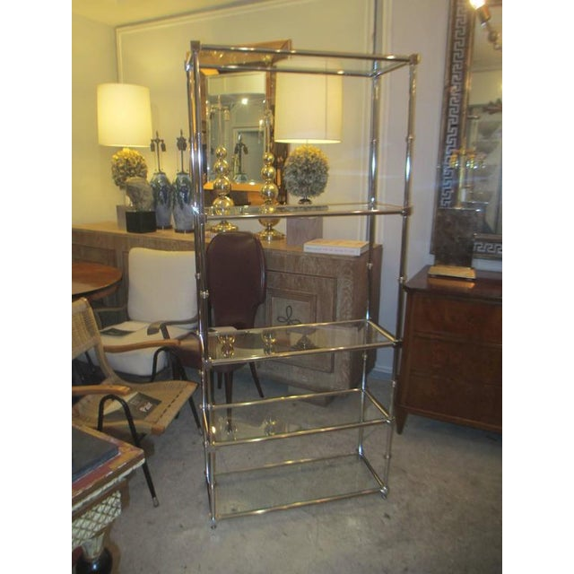 Pair of chrome and glass etageres/bookcases with glass shelves.