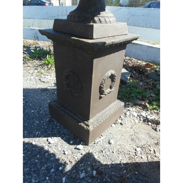 This wonderful pair of cast iron urns feature a column base holding up a very wide urn with a pedestal bottom. Lovely...