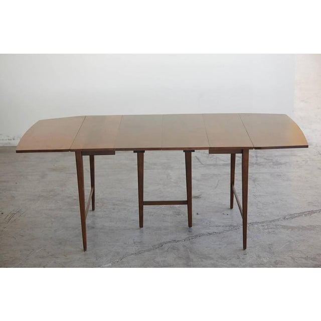 "Extendable solid maple drop-leaf dining table with three 12"" extensions offering the possibility for a table ranging from..."