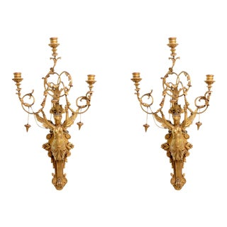 Exceptional Pair of Italian Empire Giltwood Three-Light Wall Appliques For Sale
