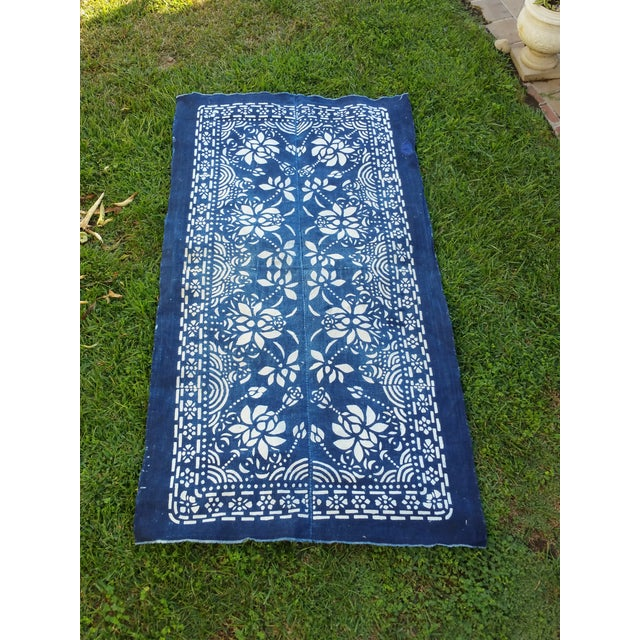A hand spun cotton indigo hand dyed batik table runner. Softly faded and lightly worn. Small hand sewn patch.
