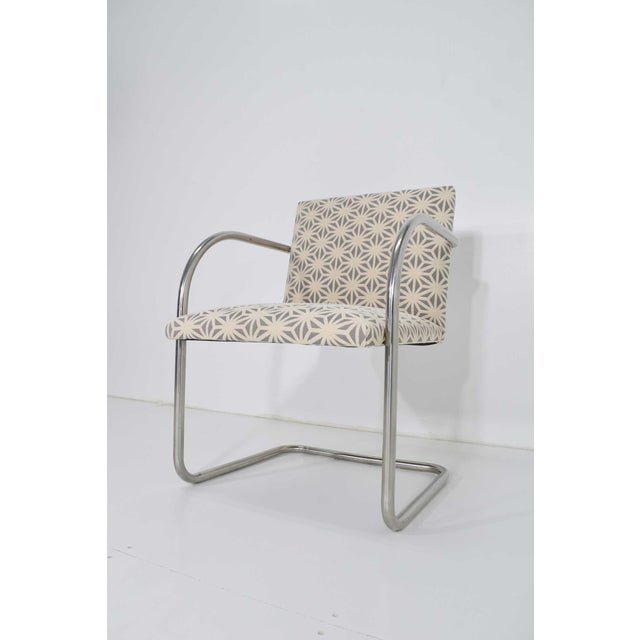 Reupholstered chairs, frames are polished stainless steel (better than the chrome plated version).