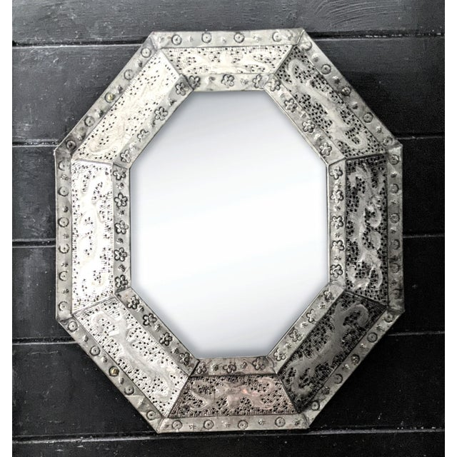 A beautiful, one of a kind mirror handcrafted of perforated metal. This striking, vintage piece perfectly embodies the...