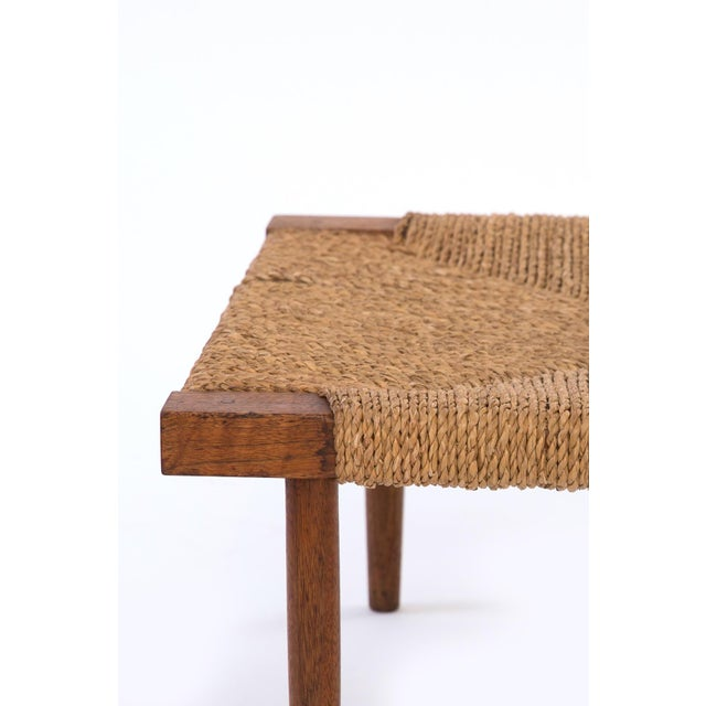 This is a fine all-original example of George Nakashima's Fitch Stool in walnut with grass cord seat, reflecting...