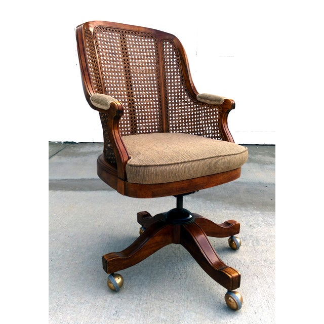 Finish off your office space with this sophisticated, vintage cane-back bergère office chair by Faultless Doerner. Chair...
