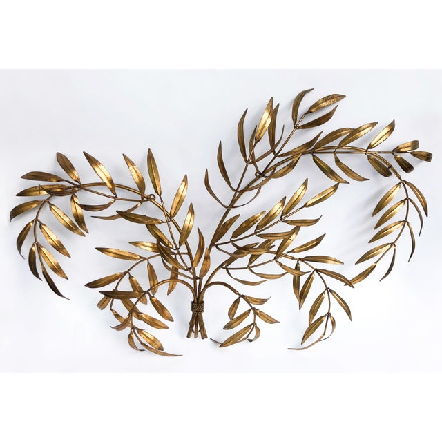 Wonderful 1960s Hollywood Regency gold leaf wall sculpture featuring a bouquet of arched branches with slender leaves....