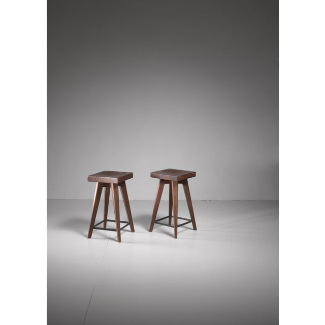 A pair of stained pine stools by French architect Christian Durupt, from a chalet at the French ski resort of Méribel. The...