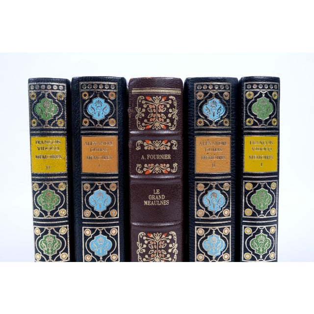 Set of five French leather-bound books published in the 1970's.