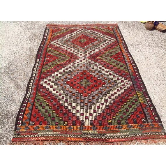 This beautiful, vintage, handwoven kilim is approximately 60 years old. It is handmade, of very fine quality in all...