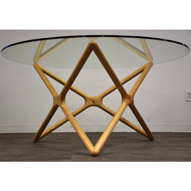 "A beautifully sculpted ash round dining table signed Sean Dix with a 1/2"" thick glass top. 59"" diameter. 29.25"" tall."