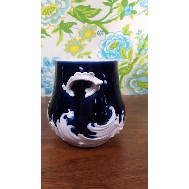 Stunning deep cobalt blue and bone white china pitcher and chamber pot with beautiful wave like detailing. Unknown age or...