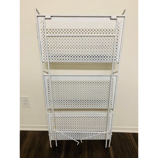 A great display item for your books, magazines or any media. Three iron and mesh shelves that can fold up flat for...