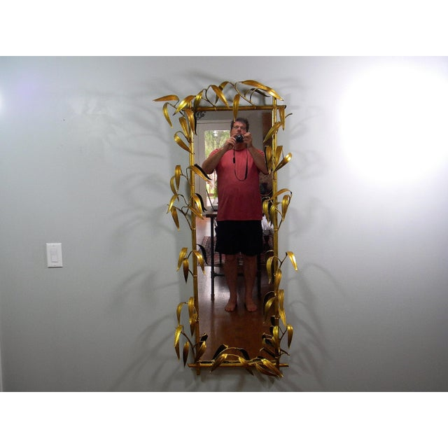 Fabulous! Vintage Faux Bamboo mirror with all gilt metal leaves in a 3 dimensional pattern. Great Hollywood regency style!