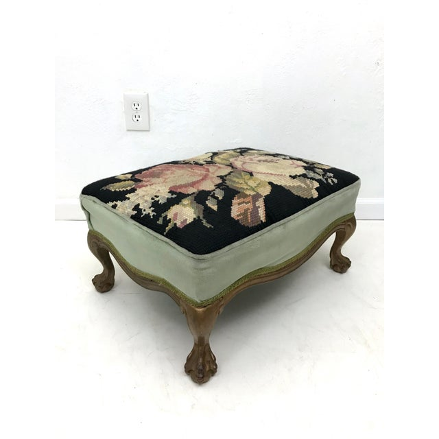 Antique Victorian footstool with needlepoint detailing and ball & claw feet - made late 19th/early 20th C. The top is...
