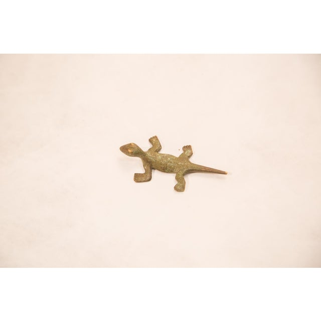Vintage handmade bronze African sculpture of a lizard with oxidized light green patina. Circa mid 20th century and...