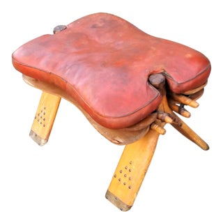 Vintage Leather Topped Camel Saddle Ottoman For Sale