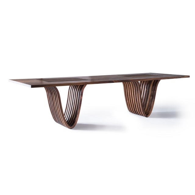 The first piece Ot/tra created--our dining table with the signature slatted opening on top, and catenary curve base. Shown...