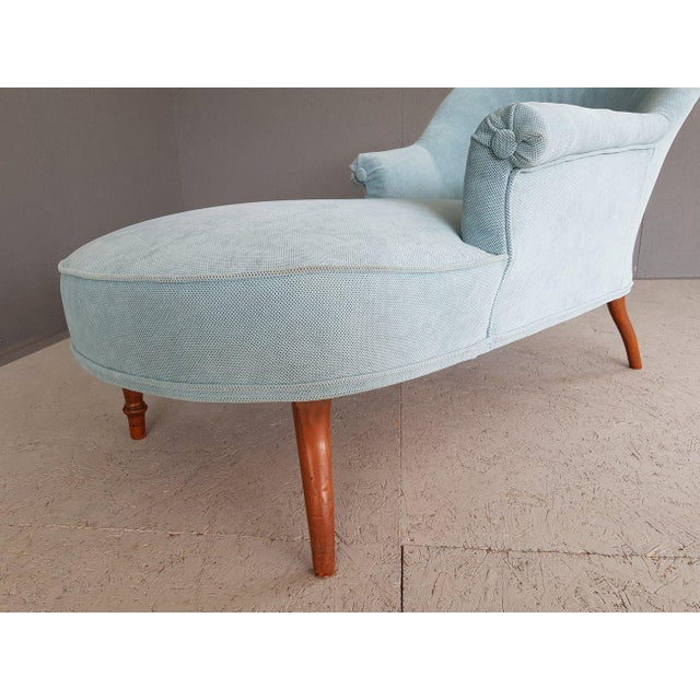 Very cute and elegant vintage chaise lounge sofa chair with completely new baby blue upholstery. Vintage furniture is...