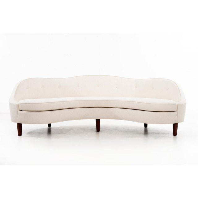 Edward Wormley (1907 - 1995) Model no. 6517 Oasis Sofa Rare curvilinear floating sofa with sloped arms, raised on tapered...