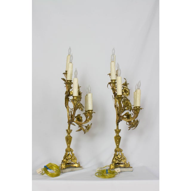 Pair of French Lily Candelabra. Completely restored and wired. Originally Candle. Gilded bronze with a marble base....
