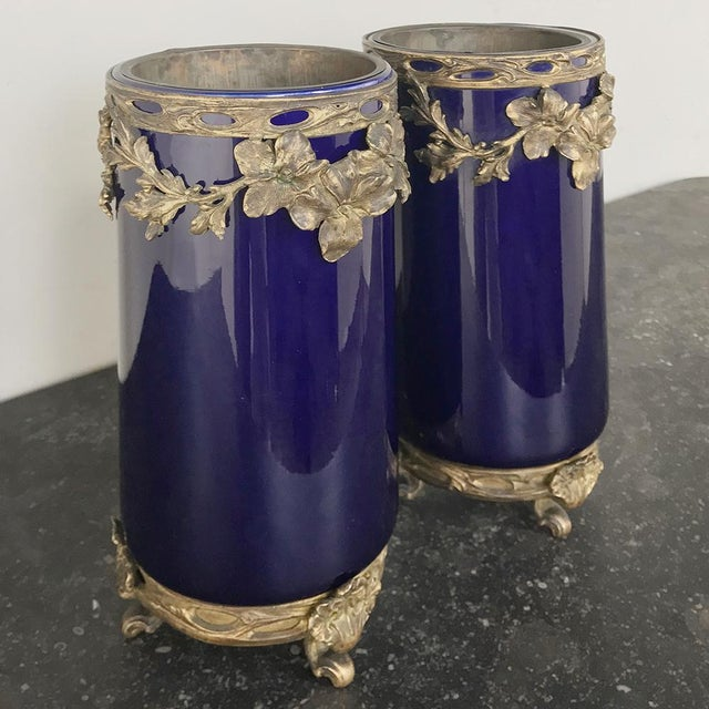 Pair of 19th Century Cobalt & Bronze Vases represent the epitome of the genre, with the luxurious deep cobalt blue...