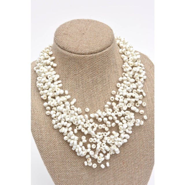 Plastic Langani Multi Strand Beaded Necklace and Pair of Matching Clip Earrings For Sale - Image 7 of 10