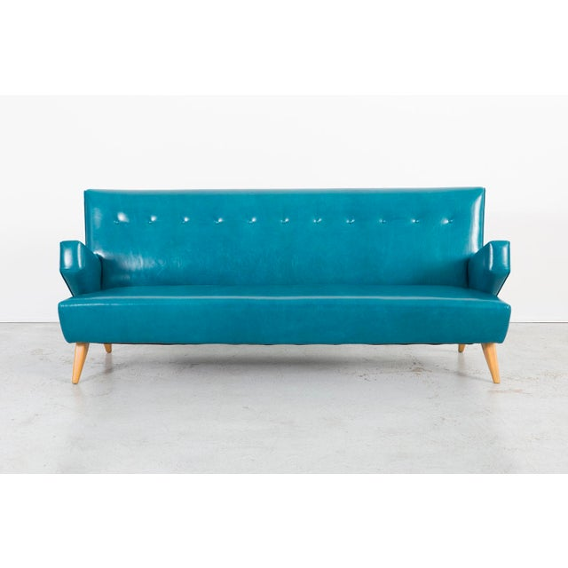 A Model 37 sofa designed by Jens Risom for Knoll in the USA, c 1960s. Reupholstered in leather and birch.