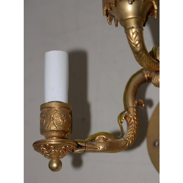 Pair of 19th Century Classical Gilded Brass Sconces Magnificent hand made wall sconces. Each sconce has three lights. The...