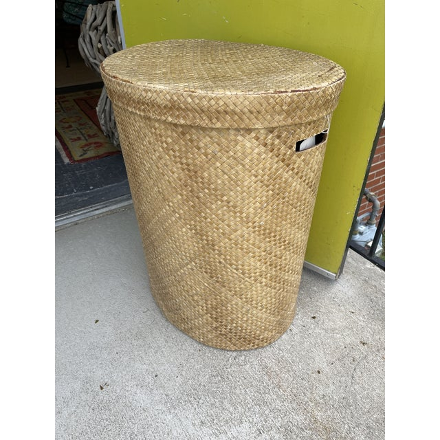 Another great wicker hamper! Oval shape woven wicker with burlap lined walls. Open handles on each side. Excellent...