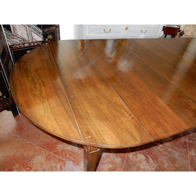Extension dining table that sits 10 very comfortably and 12 slightly tight. The original ends of the table have been...