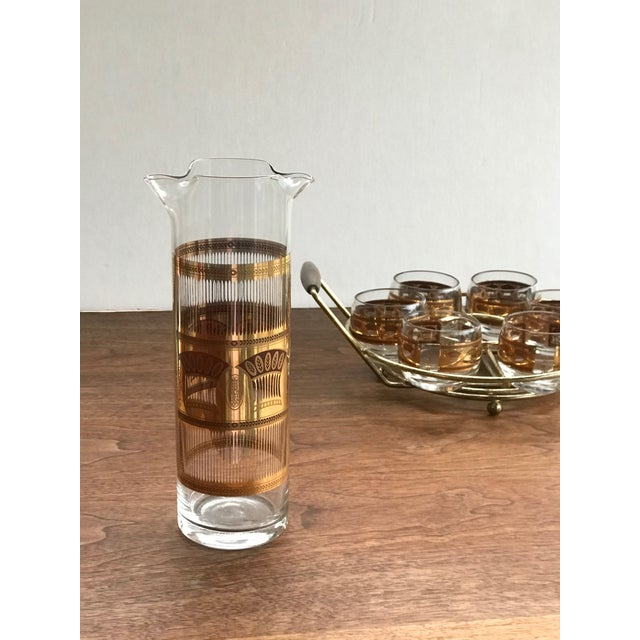 Offering this fun small roly poly glass and pitcher set by Culver. The set sits nicely in a brass carrier with walnut...