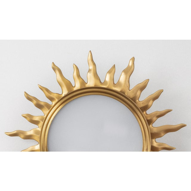 Sun burst gilded bronze and frosted glass flush mount ceiling fixture with two lights. Provenance: Marvin Alexander.