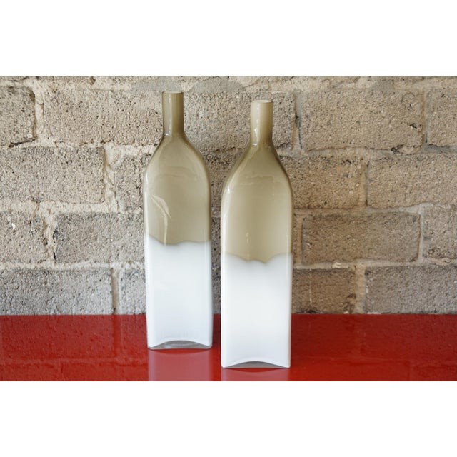 This is a pair of Mid Century cased glass bottles.