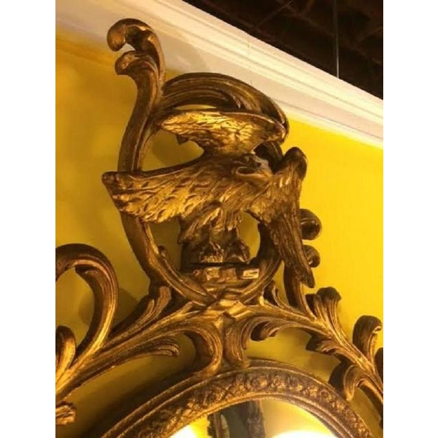Pair of carved Italian gilt decorated wall console mirrors. Each mirror in a wonderfully carved frame with scrolls and...