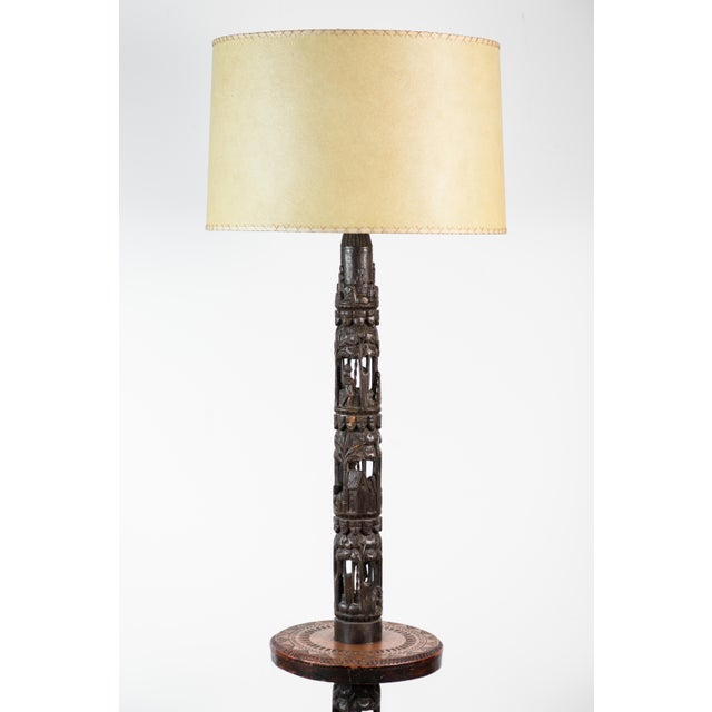 Beautiful floor lamp of African carvings assembled into a floor lamp in France mid-20th century. Fertility symbolism...