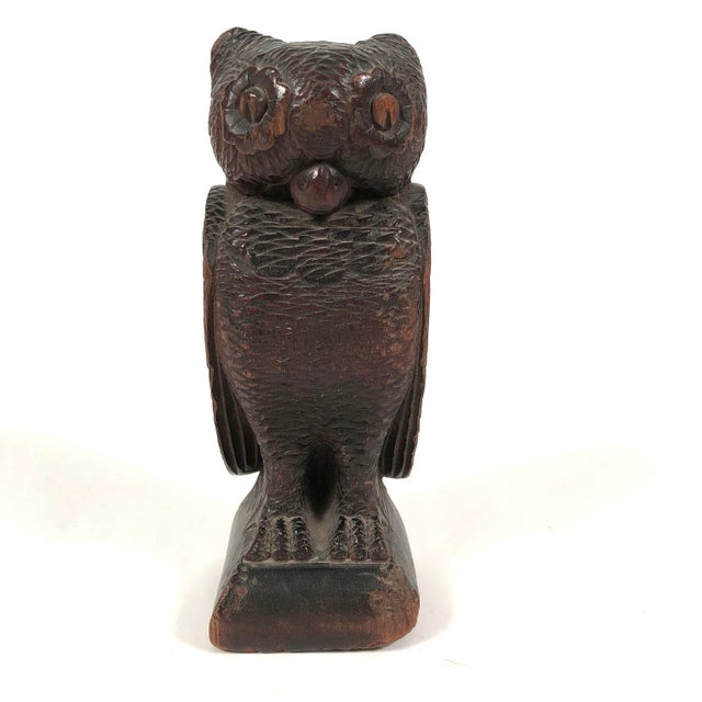 A 19th century Folk Art carved wood sculpture of an owl, facing forward with its wings by its side, animated wide open...