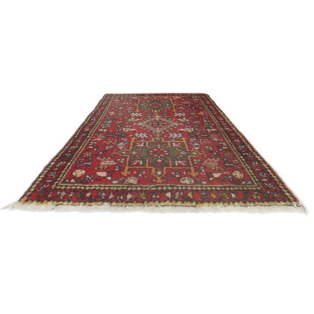 Offered is a beautiful Persian Karajeh rug. This piece is composed of hand knotted wool and features geometric designs...