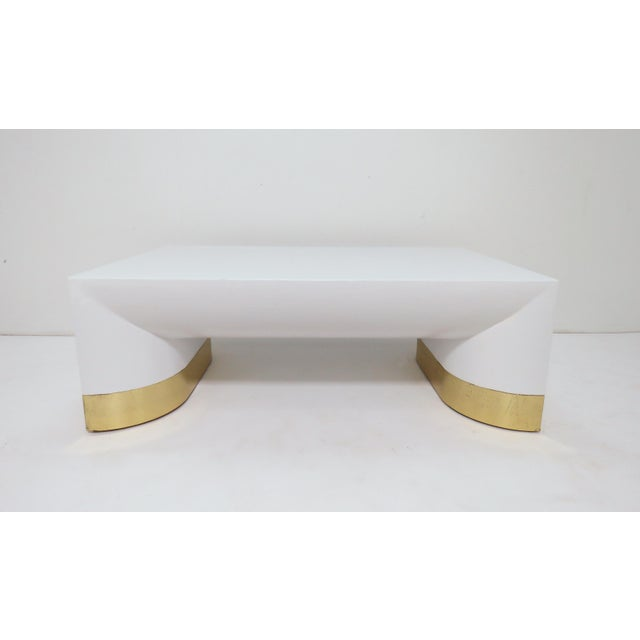 Large coffee table by Jay Spectre for Century Furniture in lacquered linen with brass toned metal accents at the legs, in...
